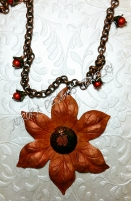 Here is a preview of one of my fall themed pieces, a beautiful rusty orange sunflower necklace.