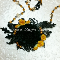 Pretty Black and Gold medium assemblage with vintage rosary chain.